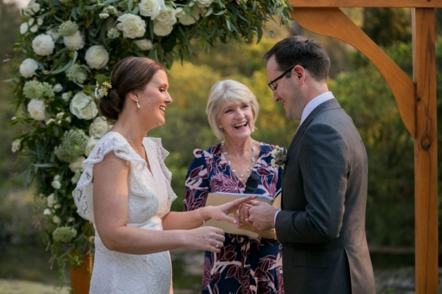 Private ring exchange joke with Vivienne Celebrant outdoors at Canungra Valley Vineyards